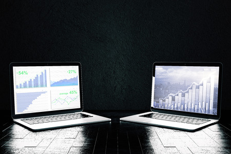 computer screen: Close up of two laptops with business and forex charts. Fund management concept. 3D Rendering