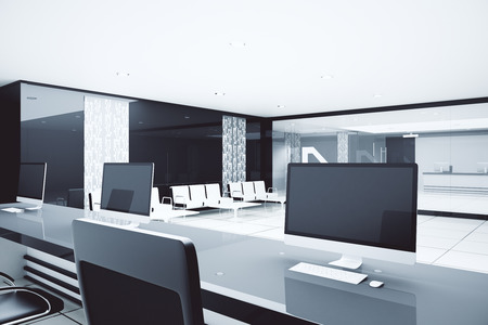 luxurious: Close up of reception desk with blank computer monitors in luxurious business interior. Mock up, 3D Rendering Stock Photo