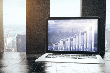 Workplace with city view and business chart on laptop screen. 3D Rendering Stock Photo