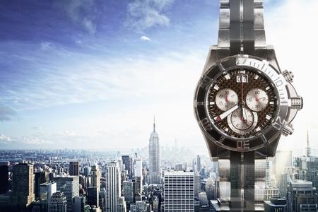 cronógrafo: Clock on city background. Time management concept Foto de archivo