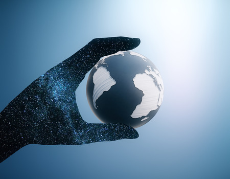 Abstract space hand holding terrestrial globe on blue background. 3D Rendering Stock Photo