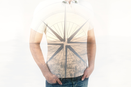 Man with compass on landscape background. Direction concept. Double exposure Stock Photo