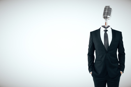 Microphone headed businessman on light background with copy space.