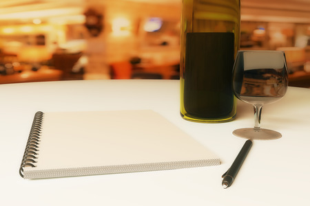Close up of dining table with blank notepad, wine, cutlery and pen. 3D Rendering Stock Photo