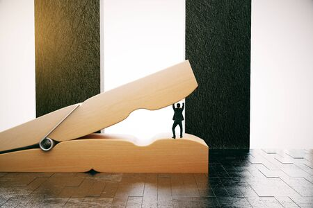 Tiny businessman preventing huge wooden clothespin from coming together in interior with daylight. Pressure concept. 3D Rendering