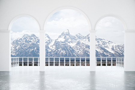 Creative modern interior with balcony, concrete columns, archs and snowy mountains view. 3D Rendering