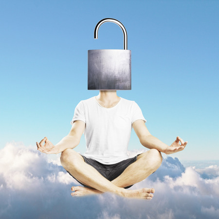 Meditating man with open iron lock instead of head on sky background. Stock Photo
