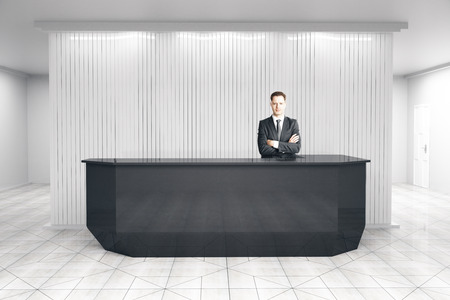 businessman at modern reception desk 3d rendering photo