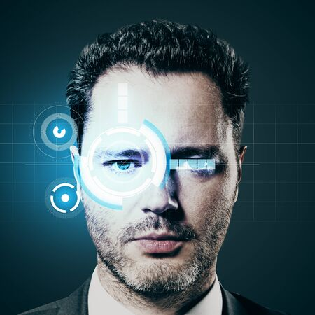up code: Security system concept. Portrait of attractive young businessman with blue digital eye Stock Photo