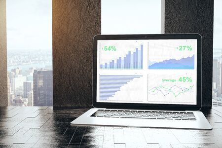 Laptop with business charts on screen placed on windowsill workplace. Finance concept. 3D Rendering Stock Photo