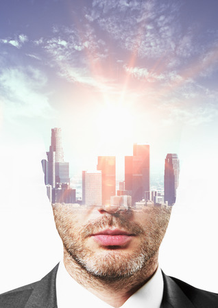 double headed: City headed businessman portrait on sky background. Double exposure Stock Photo