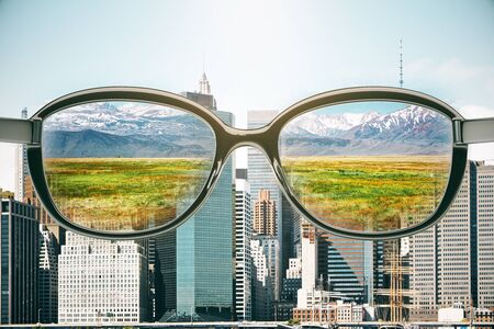 Glasses with landscape view on city background. Vision concept. 3D Rendering Stock Photo