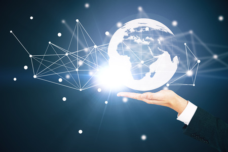 hand holding globe: Hand holding abstract illuminated globe with connections. Global business and technologies concept Stock Photo