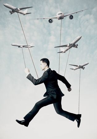full suspended: Man with ropes hanging on abstract airplanes. Sky background. Aviation concept
