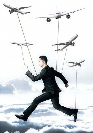 full suspended: Businessman with ropes hanging on abstract airplanes. Sky background. Aviation concept