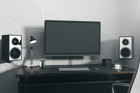 Front view of creative designer desktop with blank computer screen, speakers, coffee cup, keypad and other items. Mock up, 3D Rendering