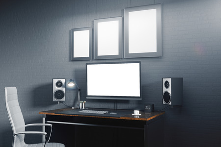 Creative designer desktop with blank white computer screen, picture frames, speakers, keypad and other items. Mock up, 3D Rendering