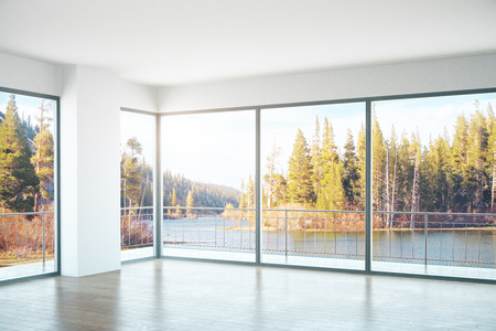 unfurnished: Unfurnished concrete interior with panoramic windows and landscape view. Side view. 3D Rendering Stock Photo