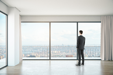 unfurnished: Businessman in unfurnished concrete interior with panoramic windows and city view. 3D Rendering Stock Photo