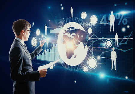Businessman with document in hand managing abstract business panel on digital background. Finance concept