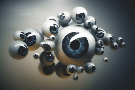 small size: Abstract collection of different sized dark blue eyeballs on grey background. 3D Rendering Stock Photo