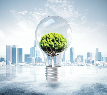 Absract lamp with tree inside on city background. 3D Rendering. Growth and idea concept