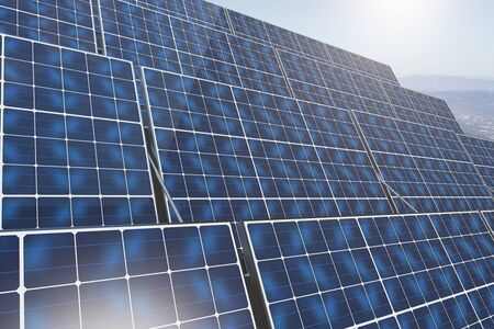 sunny side up: Side view of blue solar panels on sky background. Environment concept. 3D Rendering Stock Photo