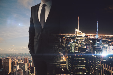 Businessman on abstract day and night city background. Overworked concept. Double exposure