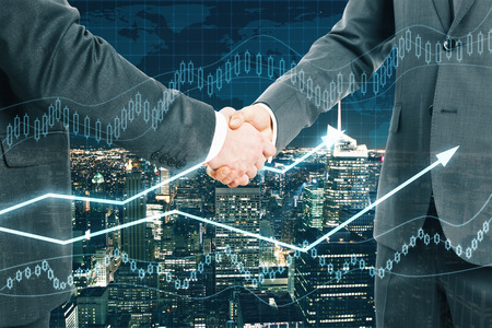 Businessmen shaking hands on night city background with forex chart. Partnership concept