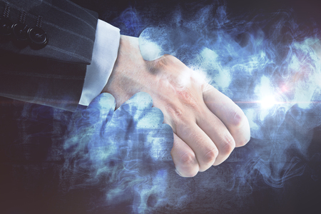 Businessperson shaking hands with abstract smoke. Creative business deal concept Stock Photo