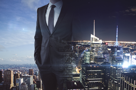 Businessperson on abstract day and night city background. Hard work concept. Double exposure
