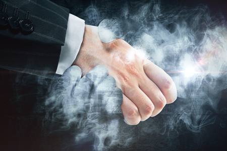 Businessman shaking hands with abstract smoke. Creative business deal concept