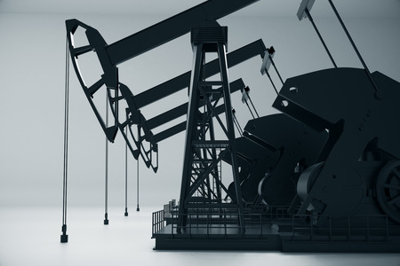 Side view of dark oil pumpjacks on light background. Industry concept. 3D Rendering