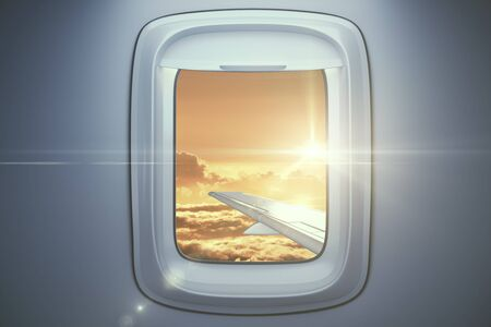 airplane wing: Airplane wing on sky with setting sun background. View from illuminator. Travel concept. 3D Rendering