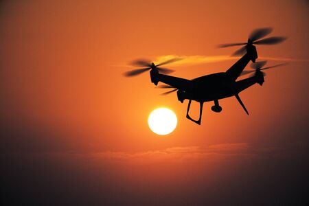 Backlit drone at sunset. Surveillance concept. 3D Rendering Stock Photo