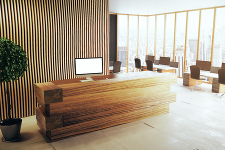 Side view of wooden reception desk with blank white computer in interior with city view and equipment. 3D Rendering