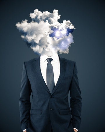 Smoke headed man with hands in pockets on light background. Confusion concept Stock Photo