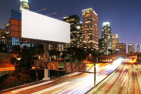 Side view of blank white billboard in nighttime city. Ad concept. Mock up, 3D Rendering