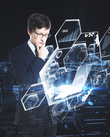 Man using laptop with honeycomb diagram hologram. City background. Double exposure. Business technology concept. 3D Rendering Stock Photo