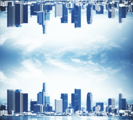 Abstract upside down city on clear sky background. Copy space Stock Photo
