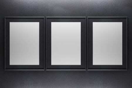 Three blank picture frames on dark concrete background. Mock up, 3D Rendering