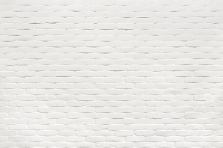 Textured white brick wall backdrop
