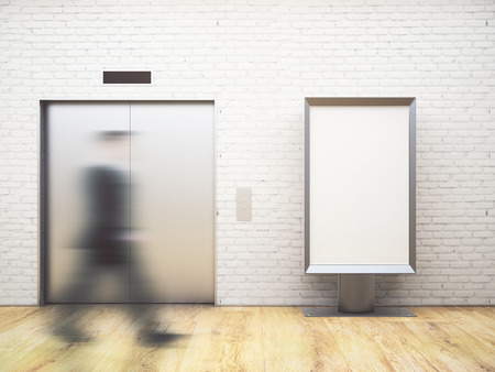Blurry businessman walking in bright interior with elevator and empty banner. Success concept. Mock up, 3D Rendering