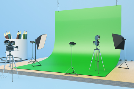 Creative tiny photo studio made out of supplies: green paper, coffee cup, pencils, glasses and other items on blue background. Sideview, 3D Rendering