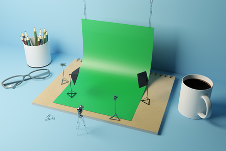 Abstract tiny photo studio made out of supplies: green paper, coffee cup, pencils, glasses and other items on blue background. 3D Rendering