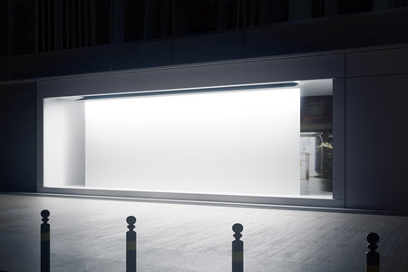 Side view of empty glass shopfront with blank white billboard at night. Retail  concept. Mock up, 3D Rendering Stock Photo - 75734346