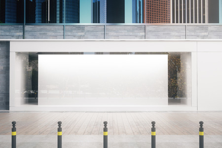 Empty glass storefront with balnk white poster in daylight. Commercial concept. Mock up, 3D Rendering