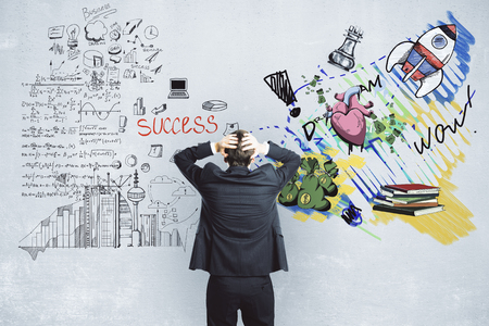 Stressed man choosing between successful career and creative art. Choice concept Stock Photo