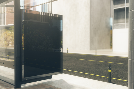 Modern bus stop with empty black poster. Mock up, 3D Rendering. Toned image Stock Photo