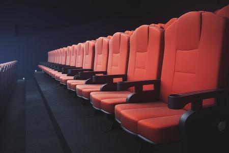 Zijaanzicht van rode bioscoopstoelen op donkere achtergrond met projector. Movie concept. 3D Rendering